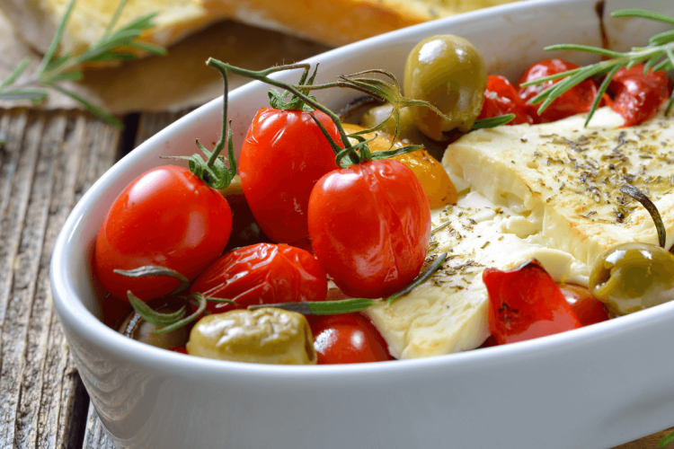 roasted greek salad recipe with tomatoes cucumber onion and feta